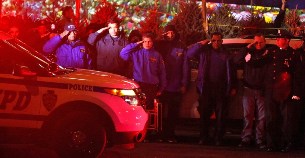 New York police officers stand outside Woodhull Hospital following the shooting deaths of two NYPD officers. (Photo: John Taggart/EPA/Newscom)