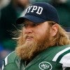 New York Jets center Nick Mangold wears a NYPD cap on his way to  the Sunday game. (Photo: New York Jets/Facebook)