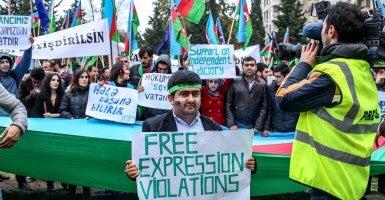 At a rally in November in Baku, Azerbaijan, people protested against violations of free expression. (Photo: Aziz Karimov/Pacific Press/Sipa USA/Newscom)