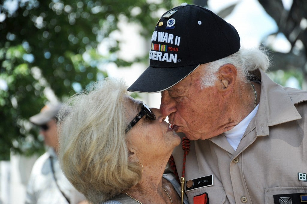 A veteran an his wife share a kiss near the World War II memorial on June 7, 2014. (Photo: Katherine Cresto/CC BY-NC 2.0)