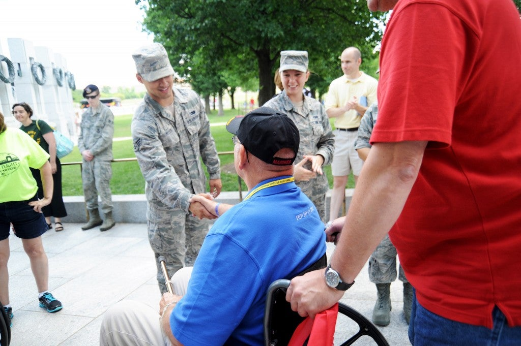 Veterans from New York, Ohio and New Jersey are welcomed to the memorial by current servicemen and women in June 2014. (Photo: Katherine Cresto/CC BY-NC 2.0)