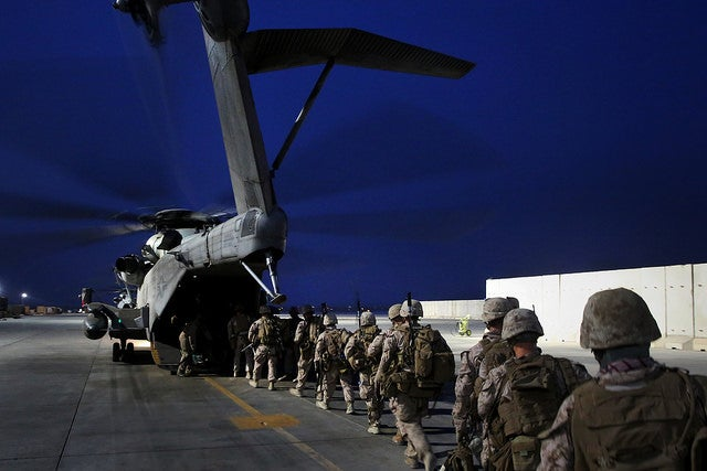 Marines with Bravo Company, 1st Battalion, 7th Marine Regiment, load onto a CH-53E Super Stallion with Marine Heavy Helicopter Squadron 466 prior to a mission in Helmand province, Afghanistan, June 5, 2014. The company conducted disruption operations in a known Taliban bed-down location for two days. (Photo: Cpl. Joseph Scanlan / released)