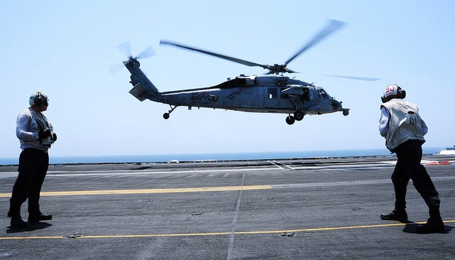 An MH-60S Sea Hawk, attached to the âTridentsâ of Helicopter Sea Combat Squadron (HSC) 9, carrying Vice Adm. William Moran, Chief of Naval Personnel, Capt. Michael Bernacchi and Fleet Master Chief April Beldo, takes off from the flight deck of the aircraft carrier USS George H.W. Bush (CVN 77) and transits to the guided-missile destroyer USS Roosevelt (DDG 80) on Aug. 9. (Photo: U.S. Navy photo by Mass Communication Specialist 3rd Class Joshua Card)