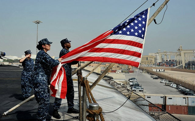 Sailors raise the national ensign as the aircraft carrier USS George H.W. Bush (CVN 77) pulls into Jebel Ali, Dubai for a scheduled port visit on Aug. 2. (Photo: U.S. Navy photo by Mass Communication Specialist 3rd Class Margaret Keith)