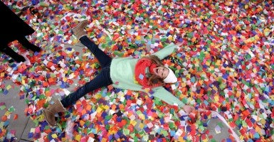 Nicole Tacher-Lois, 11, of Miami plays in the confetti at the Marriott Marquis in Times Square after midnight on New Year's Eve in New York City on Jan. 1, 2014. (Photo: John Angelillo/UPI/Newscom)