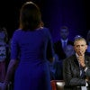President Barack Obama listens to remarks from Taya Kyle, widow of U.S. Navy SEAL Chris Kyle, during CNN's live forum on gun control. (Photo: Kevin Lamarque/Reuters/Newscom)