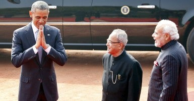 President Obama is greeted in New Delhi, India, by President Pranab Mukherjee and Prime Minister Narendra Modi on Jan. 25, 2015. (Photo: Ajay Aggarwal/Hindustan Times/Newscom)