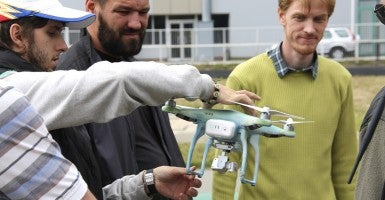 Kyiv IT Academy students teach Ukrainian special operations soldiers to operate a small surveillance drone. (Photo: Nolan Peterson/The Daily Signal)