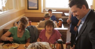 Scott Womack chats with customers at his Terre Haute, Ind., IHOP in 2011. Last year, he sold this and 15 other IHOP restaurants due to rising labor costs associated with Obamacare. (Photo: Freethink Media)