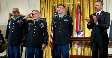 President Obama applauds Medal of Honor honorees, from left, Staff Sergeant Melvin Morris, Sergeant First Class Jose Rodela, and Specialist Four Santiago J. Erevia. (Photo:The White House/Sipa USA/Newscom)