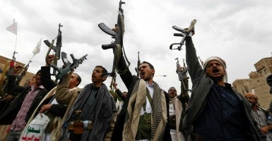 Armed Houthi members hold their guns in the air while shouting anti-Saudi slogans during a rally protesting Saudi-led airstrikes against Houthi positions in Sana'a, Yemen. (Photo: Yahya Arhab/EPA/Newscom)