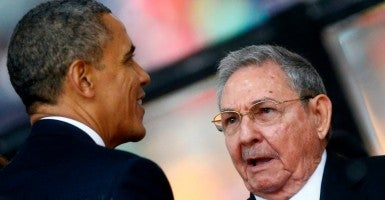 President Obama greets Cuba's President Raul Castro. (Photo: Kai Pfaffenbach/Reuters/Newscom)