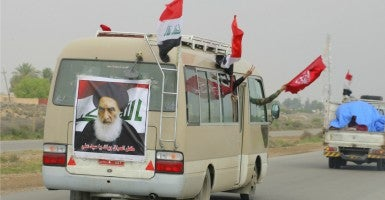 A poster of Iraq's top Shi'ite cleric Grand Ayatollah Ali al-Sistani, is seen at the back of a vehicle used by Hashid Shaabi (Popular Mobilisation) forces, which allied with Iraqi forces against the Islamic State. (Photo: Alaa Al-Marjani/Reuters/Newscom)
