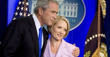 President George W. Bush hugs soon-to-be White House press secretary Dana Perino on Aug. 31, 2007. (Photo: Joshua Roberts/EPA/Newscom)
