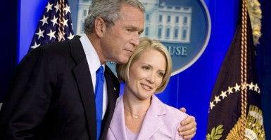 President George W. Bush hugs soon-to-be White House press secretary Dana Perino on Aug. 31, 2007. (Photo: Joshua Roberts/EPA/Newscom)