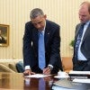 President Obama confers with Ben Rhodes, deputy national security adviser, in the Oval Office.