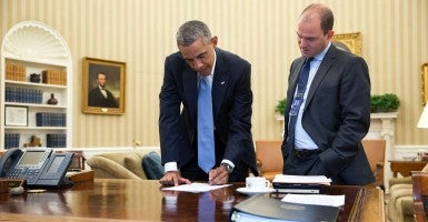 President Obama confers with Ben Rhodes, deputy national security adviser, in the Oval Office. (Photo: Pete Souza/White House)