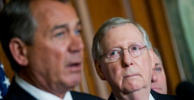 Senate Majority Leader Mitch McConnell, R-Ky., right, looks on as Speaker John Boehner, R-Ohio, makes remarks. (Photo By Tom Williams/CQ Roll Call)