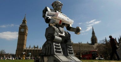 A robot in front of the Houses of Parliament and Westminster Abbey as part of the Campaign to Stop Killer Robots in London. (Photo: Luke Macgregor/Reuters/Newscom)