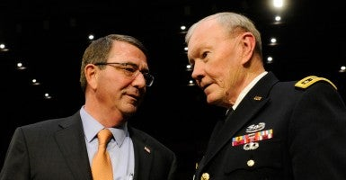Defense Secretary Ashton Carter, left, and Gen. Martin E. Dempsey, chairman of the Joint Chiefs of Staff, prepare to testify before a Senate Armed Services Committee hearing. (Photo: Bao Dandan/Xinhua News Agency/Newscom)