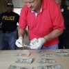A detective counts cash found at a crime scene in Lumberton, N.C., something  quite different from what's happening to law-abiding Americans. (Photo: David Swanson/MCT/Newscom)