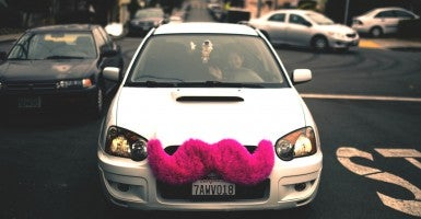 Lyft uses a mobile-phone application to allow ridesharing—connecting passengers with drivers in cars donning the company's signature pink mustache. (Photo: Alfredo Mendez/Flickr/CC BY 2.0)