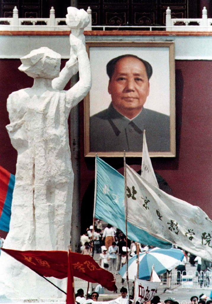 "A portrait of China's late chairman Mao Zedong overlooks the ""Goddess of Democracy,"" modeled after the Statue of Liberty, in Beijing's Tiananmen Square in this June 1989 photo. (Photo: STRINGER/CHINA/REUTERS/Newscom)"