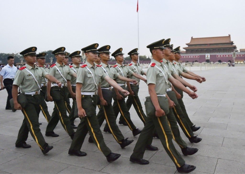Armed police officers march at Tiananmen Square in Beijing on June 4, 2015, the 26th anniversary of the bloody crackdown on pro-democracy demonstrators. (Photo: Kyodo/Newscom)