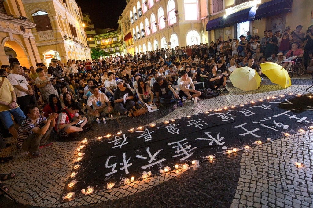 People attend a vigil in memory of the victims of the Tiananmen massacre, in Macau, China, 04 June 2015, marking the 26th anniversary of the government crackdown on pro-democracy demonstrations at Tiananmen Square. (Photo: CARMO CORREIA/EPA/Newscom)