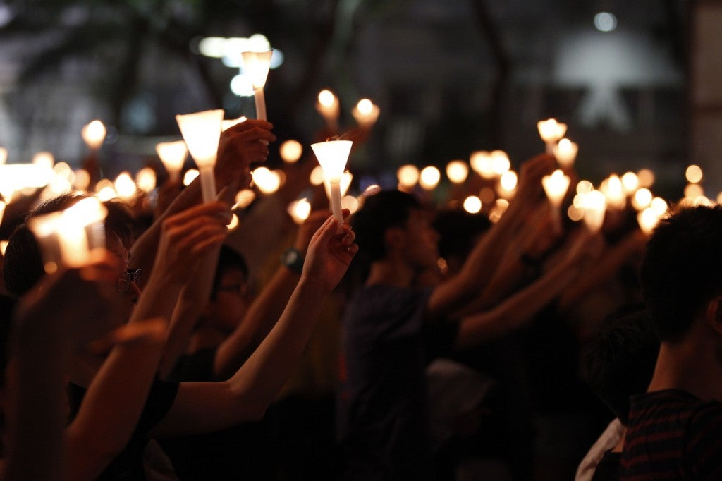 Participants take part at the candlelight vigil as they hold candles in Victoria Park on June 4, 2015 in Causeway Bay, Hong Kong, just months after their own pro-democracy protests. (Photo: David G. Mcintyre/ZUMA Press/Newscom)