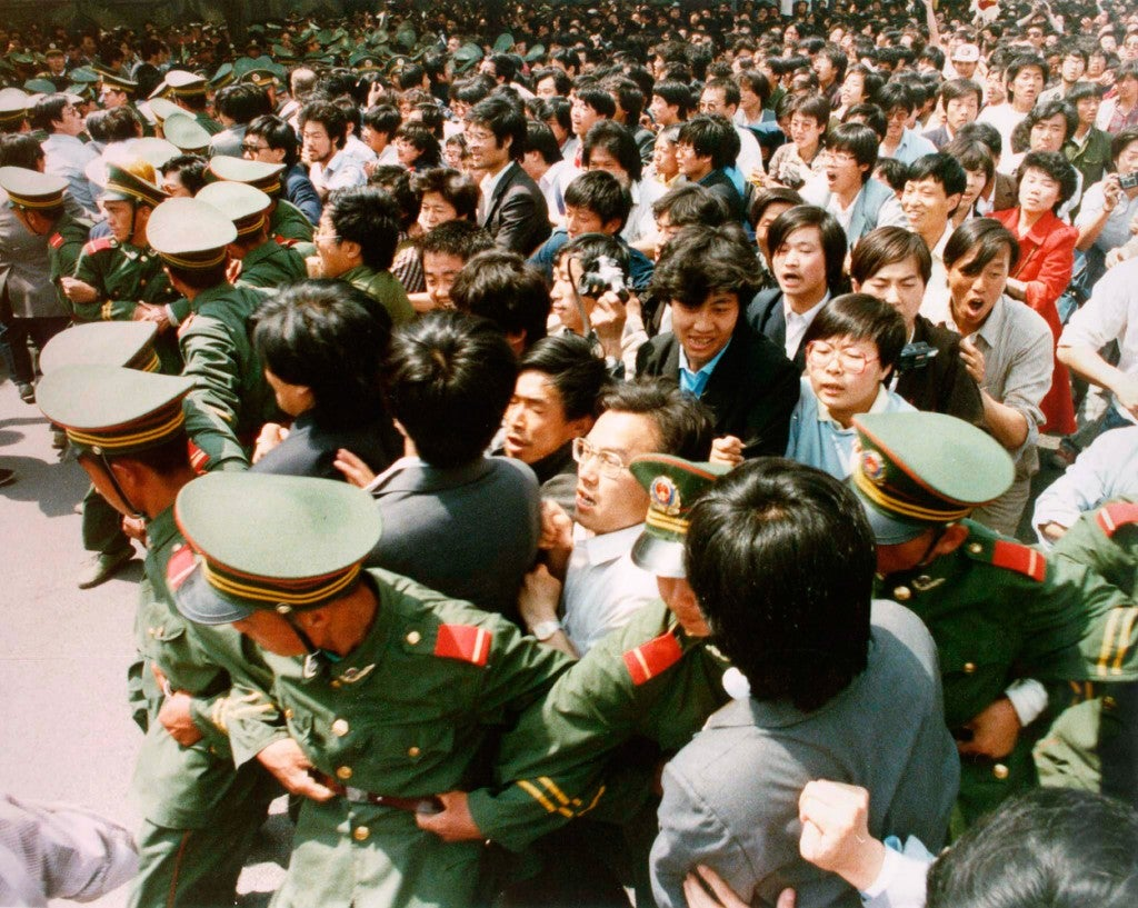 Crowds of jubilant students surge through a police cordon before pouring into Tiananmen Square during a pro-democracy demonstration in this June 4, 1989 photo. (Photo: STRINGER/REUTERS/Newscom)
