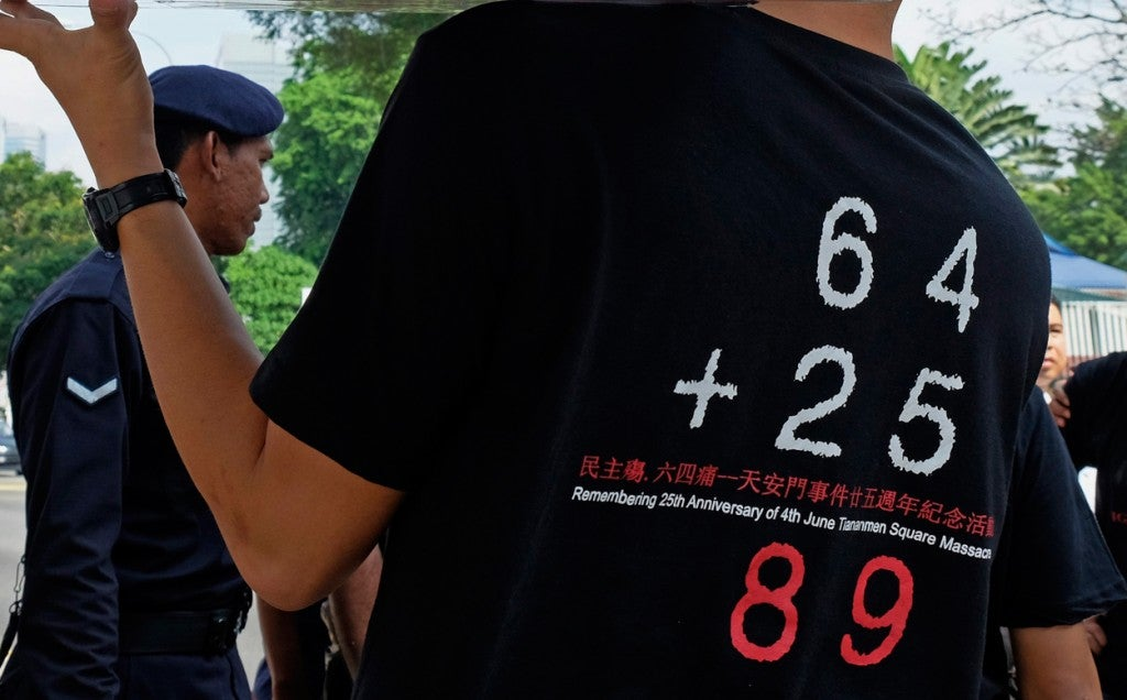 A protester wears a shirt showing numbers significant to the Tiananmen Square tragedy during a protest in front of the Chinese Embassy in Kuala Lumpur, Malaysia, 04 June 2014. The protest was held last year to commemorate the 25th anniversary of the Tiananmen Square tragedy where China's military did a crackdown on pro-democracy protesters in 1989. (Photo: SHAMSHAHRIN SHAMSUDIN/EPA/Newscom)