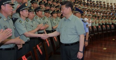 Chinese President Xi Jinping, also general secretary of the Communist Party of China, meets with senior officers of Zhejiang Military Area Command during an inspection tour. (Photo: Li Gang/Chine Nouvelle/SIPA/Newscom)