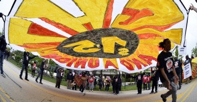 Protesters demonstrate in front of McDonald's corporate headquarters demanding a wage increase to $15 per hour on May 20, 2015, in Oak Brook, Ill. (Photo: Brian Kersey/UPI/Newscom)