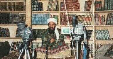 When issuing pronouncements, Osama bin Laden often sat in front of shelves of Islamic books to convey an intellectual image. (Photo: Polaris/Newscom)