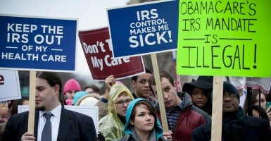 Activists demonstrate in front of the Supreme Court on March 4, 2015, as the Justices heard oral arguments in the King v. Burwell case that challenges the section of Obamacare. (Photo: Pete Marovich/UPI/Newscom)