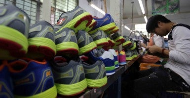 A man works in a factory making sneakers in China. (Photo: Yuan He/Feature China/Newscom)