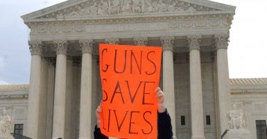 A pro-gun advocate stands outside of the Supreme Court during the District of Columbia v. Heller case in March, 2008. (Photo: Kevin Dietsch/UPI)