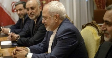 The head of the Iranian Atomic Energy Organization Ali Akbar Salehi and Iranian Foreign Minister Javad Zarif (Photo: POOL/REUTERS/Newscom)