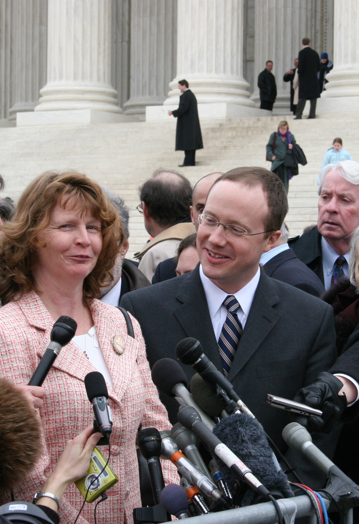 Susette Kelo and Institute for Justice lawyer Scott Bullock stand outside the Supreme Court after oral arguments in the case Kelo v. City of New London. (Photo: Institute for Justice)