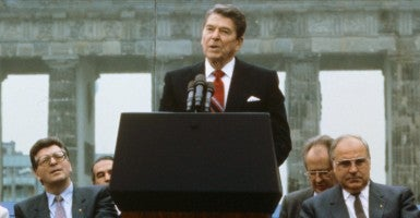 On June 12, 1987, President Ronald Reagan declared, 'Mr. Gorbachev, open this gate. Mr. Gorbachev, tear down this wall.' He's next to German Chancellor Helmut Kohl (right) and Speaker of the German Parliament Philipp Jenninger (left) at the Berlin Wall in front of the Brandenburg Gate in West Berlin, Germany.  (Photo: STR/EPA/Newscom)