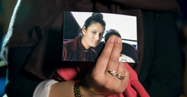 Renu Begum holds a picture of her younger sister, Shamima Begum, a 15-year-old British girl who fled with two friends to join ISIS after being recruited on Twitter and other social media platforms. (Photo: Lean Laura/PA Photos/ABACA/Newscom)