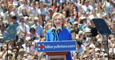 'Now it's time ...  to secure the gains and move ahead,' Hillary Rodham Clinton urges her audience on Roosevelt Island. (Photo: Sam Simmonds/Polaris/Newscom)