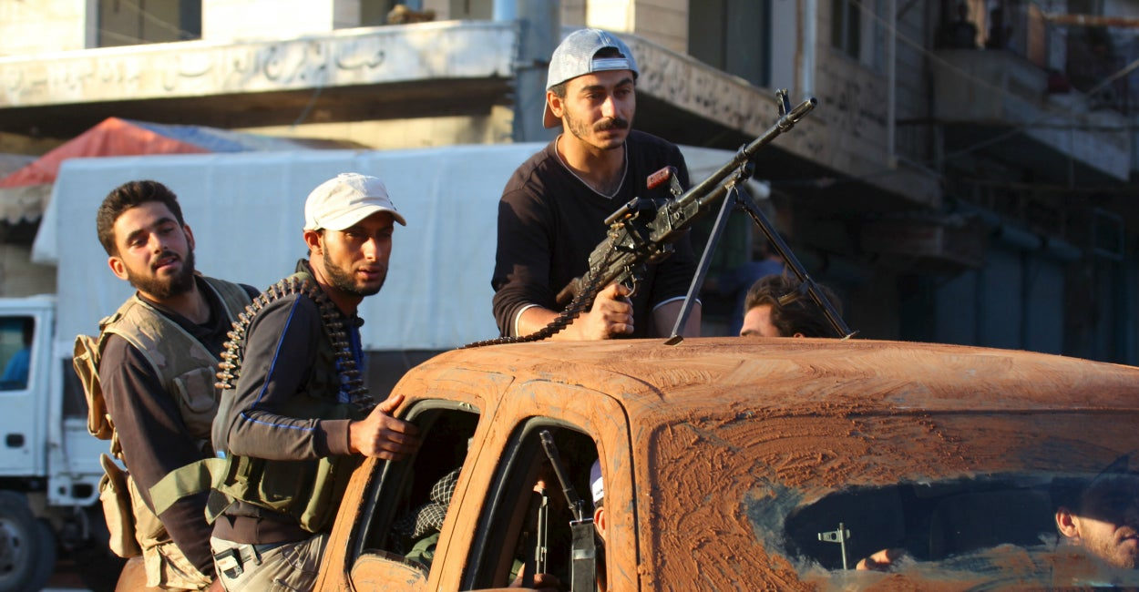 Members of al Qaeda's Nusra Front move through northwestern Sryia May 29, 2015. (Photo: Ammar Abdullah/Reuters/Newscom)