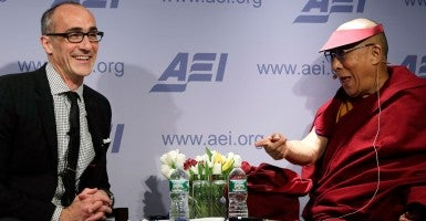 Arthur Brooks, president of the American Enterprise Institute, chat with the Dalai Lama in Washington, Feb. 20, 2014. (Photo: Gary Cameron/Reuters/Newscom)