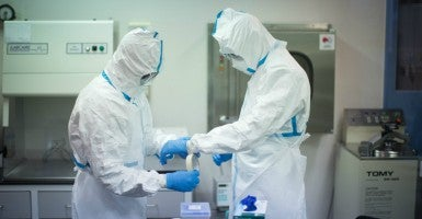 Workers in a laboratory prepare to investigate Ebola samples at the University of Ghana. (Photo: Kay Nietfeld/EPA/Newscom)
