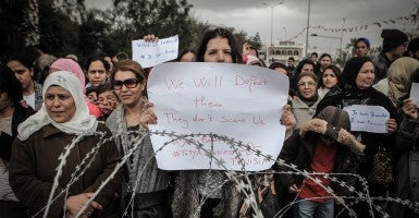Demonstrators protest outside Tunisia's Bardo National Museum in Tunis, condemning the attack on the tourist site in March that killed 21 people. (Photo: Ileyes Gaidi/ZUMA Press/Newscom)