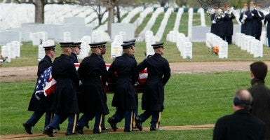 The Old Guard from the U.S. Army's 3rd Infantry Regiment pallbearers carry a casket holding the remains of a group of 11 World War II airmen missing in action since 1943 that have been recently identified. (Photo: Hyungwon Kang/Reuters/Newscom)