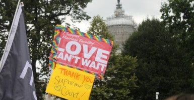 With the U.S. Capitol as a backdrop, activists celebrate the court's same-sex marriage decision. (Photo: Jessi Rapelje/The Daily Signal)
