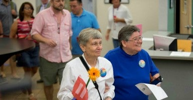 In Travis County, Texas, Jacque Roberts and her partner, Carmelita Cabello, wait in line for a marriage license June 26, after the Supreme Court's ruling. (Photo: Bob Daemmrich/Polaris/Newscom)